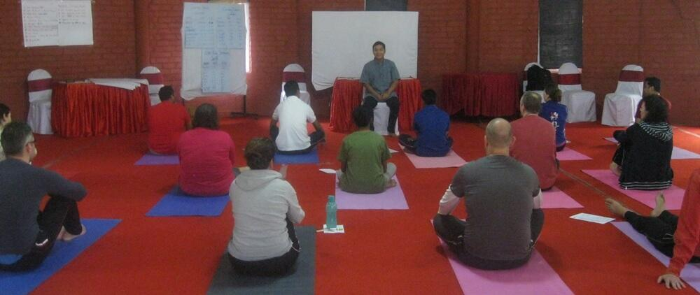 Chow Siddhartha conducting a yoga course for a Netherland group